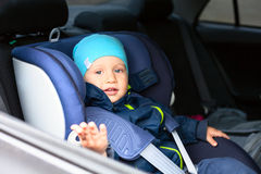 Child car guard seat. Child car blue guard seat with a boy Stock Photo