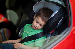Child in car seat wearing belt Royalty Free Stock Photos