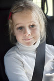 Child in car with seatbelt Royalty Free Stock Photos
