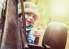 Child in the car at sunset. Stock Images