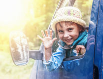 Child in the car at sunset. Royalty Free Stock Photos