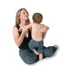 Child Care. A woman (mother) lets a baby run into her arms for comfort. Taking care of children Stock Photo