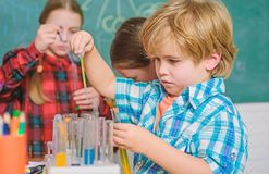 Child care and development. School classes. Kids adorable friends having fun in school. School chemistry lab concept stock image