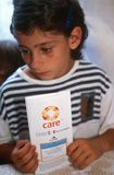 A child with a CARE handbook in Kosovo. Stock Photos