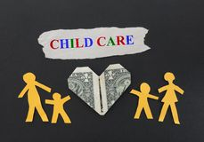 Child Care. Paper cutout family with Child Care text Stock Photo