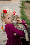 Child caressing big cat Stock Image