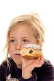 Child in a carnival, with donuts. Royalty Free Stock Image