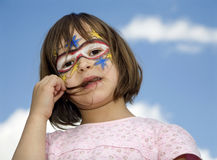 Child with the carnival mask on the face Royalty Free Stock Photo