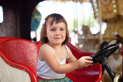 Child in carousel car Royalty Free Stock Photos