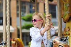 Child On Carousel Stock Photo
