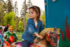 A child on a carousel in the Park Royalty Free Stock Images