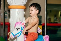 Child on a carousel Stock Images