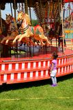 Child and carousel stock photo