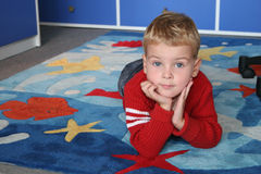 Child on carpet Stock Image