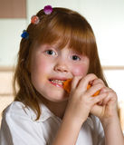 Child with carrot Stock Images