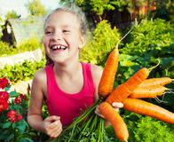 Child with carrot Royalty Free Stock Photos