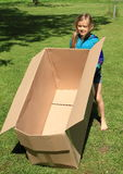 Child carrying a box Royalty Free Stock Images