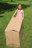 Child carrying a box Royalty Free Stock Photo