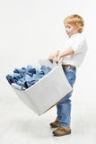 Child carrying box with jeans. Kids clothing Stock Photos