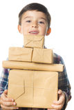 Child carrying Christmas gifts Stock Photo