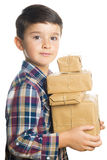 Child carrying Christmas gifts Stock Image