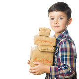 Child carrying Christmas gifts Royalty Free Stock Images