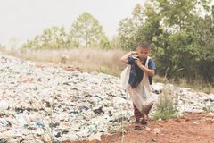 Child carrying a garbage bag to sell, the lives and lifestyles o royalty free stock images