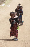 Child carrying her brother in Africa Stock Image