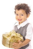 Child carrying a present Royalty Free Stock Photography