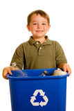 Child carrying recycling bin. Recycling concept with young child carrying recycling bin isolated on white Royalty Free Stock Images