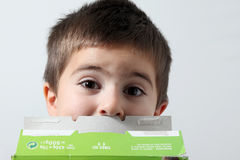 Child with carton box Royalty Free Stock Photo