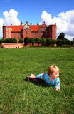 Child by castle manor house Stock Photos