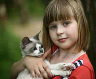 Child and a cat. Portrait of the childl with a cat Royalty Free Stock Images