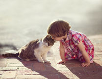 Child with Cat Royalty Free Stock Images