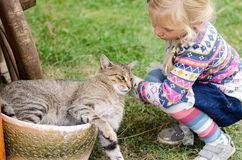 Child and cat Stock Images
