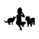 Child with cat and dog silhouette illustration in black Stock Images