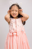 Child with Cat Ear Headband in Pink Dress, Isolated on White Royalty Free Stock Photo