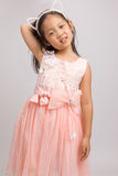 Child with Cat Ear Headband in Pink Dress, Isolated on White Royalty Free Stock Photos