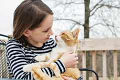 Girl holding cat looking at each other Royalty Free Stock Images