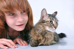 Child and cat looking with surprise Royalty Free Stock Image
