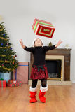 Child catching christmas present Stock Photography