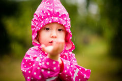 Child catching rain Royalty Free Stock Images