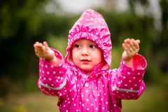 Child catching rain Stock Photos