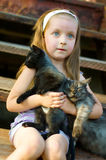 Child with cats Royalty Free Stock Image