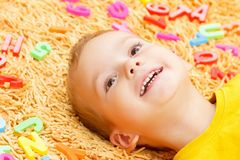 Child playing with letters beginning of the year. Stock Photography
