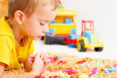 Child playing with letters beginning of the year. Royalty Free Stock Images