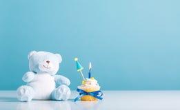 Child celebration theme with a cupcake Royalty Free Stock Photos