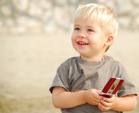 Child with cell phone Royalty Free Stock Photography