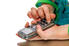 Child with a cell phone Royalty Free Stock Image