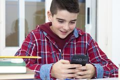 Child with the cellphone. At school royalty free stock image